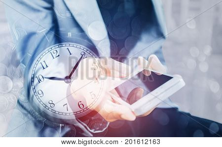 Double exposure of businessman holding smart phone with a row of stack money coins and analog clock concept for business finances and saving money.