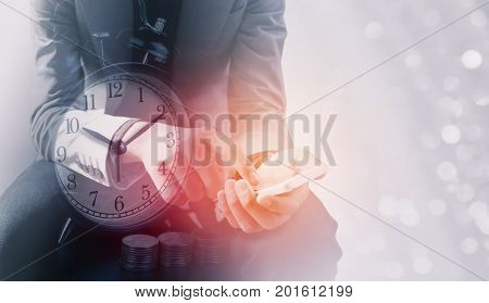 Double exposure of businessman use smart phone with a row of stack money coins and analog clock concept for business finances and saving money.