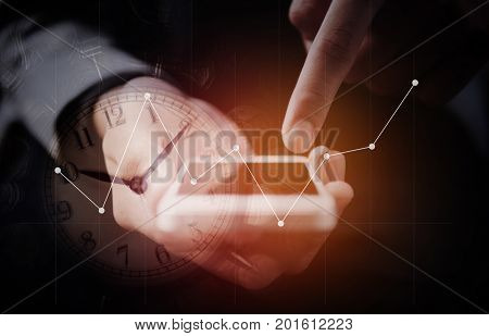 Double exposure of businessman use smart phone with a row of stack money coins and analog clock with business graph information diagram concept for business finances and saving money.