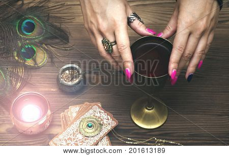 Tarot cards on fortune teller table. Divination. Witchcraft. Witch prepares a magic potion.
