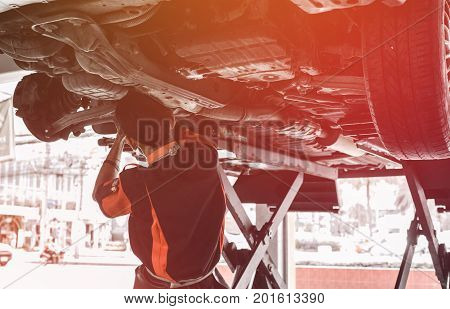 Car Lifted In Automobile Service For Fixing. Garage Automobile Service