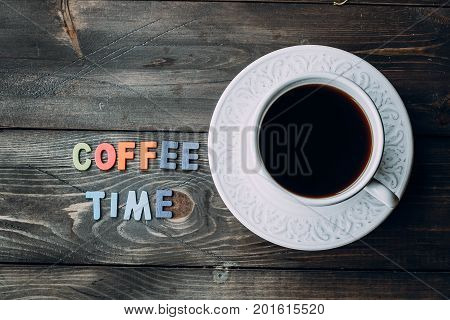 Cup Of Coffee On A Wooden Table.