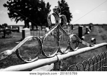 Closeup of old metal cemetery gate graveyard