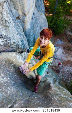 Girl Climber Climbs The Rock.