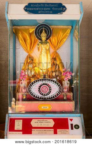 Device With Buddha Statue For Fortune-telling