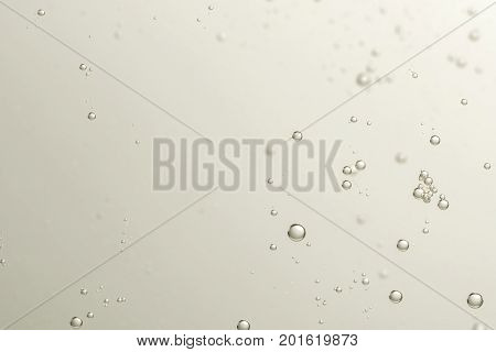 Soda fizz bubbles isolated over a blurred background