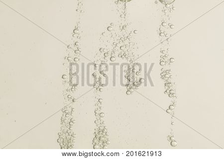 Beautiful golden champagne fizz bubbles over a blurred background