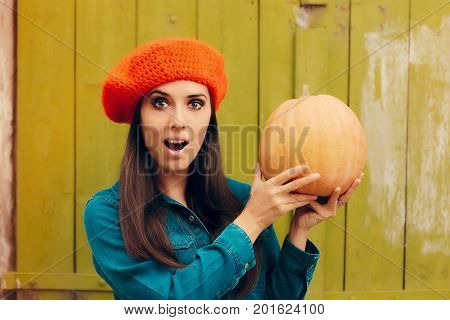 Amazed Funny Autumn Woman with Orange Beret Holding Pumpkin