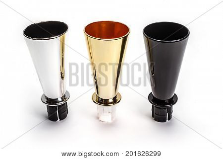 Wine pourers: silver, golden, black on white background