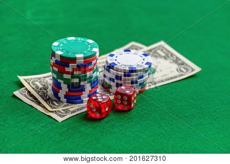 Casino green table with chips, money and dices. Poker game concept