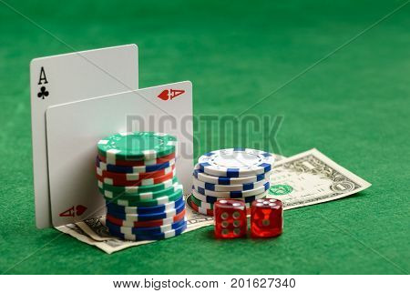 Casino green table with play cards, chips, money and dices. Poker game concept