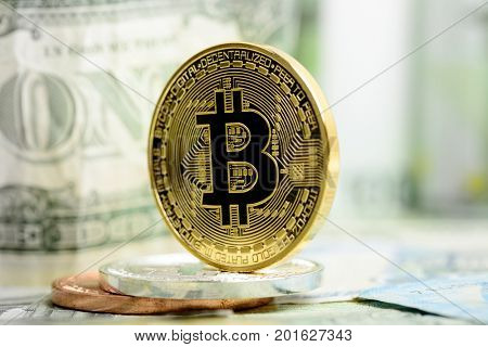 Golden bitcoin on money background. Bitcoin cryptocurrency concept