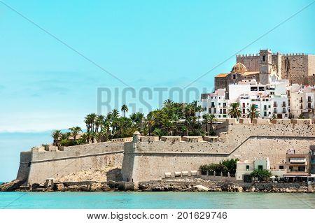 A photo of the castle of Peniscola, in the province of Castellon, Valencian Community, Spain, Costa del Azahar, along the Mediterranean coast, a popular tourist destination