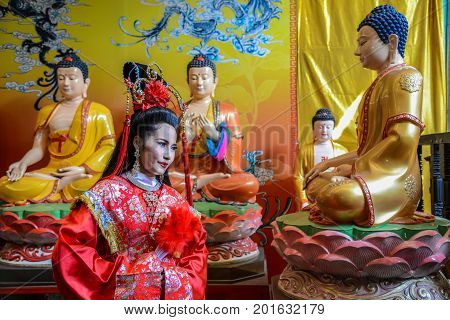 Chachoengsao Thailand - July 14 2013 : Beautiful woman with traditional chinese red dress in Chinese shrine in Thailand.