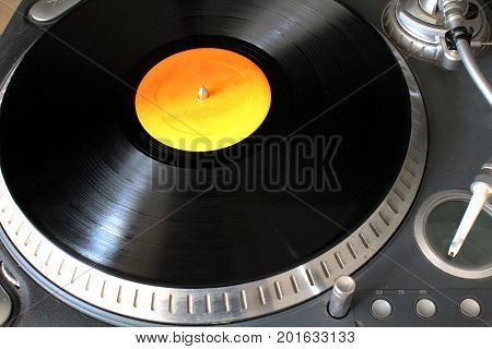 a turntable with vinyl disc on it