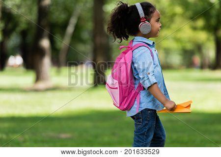 African American Schoolkid In Headphones