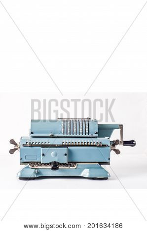 Old Calculating Machine Isolated On White Background. Accounting Or Business Concept
