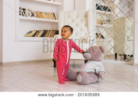 Portrait of a little african american baby boy playing indoor.