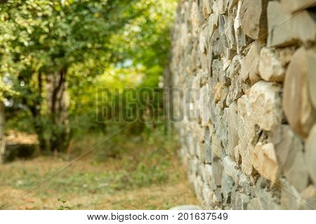 Old vintage stone wal with perspective view and blurred background. Selective focus