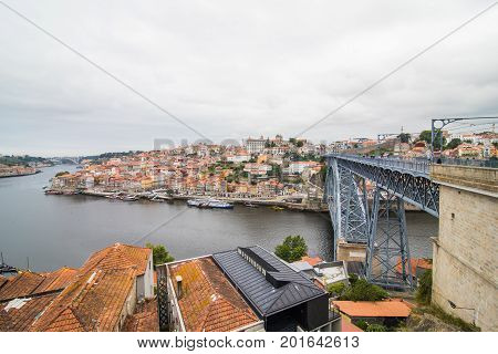 Porto, Portugal - July 2017. View Of The Iconic Dom Luis I Bridge Crossing The Douro River, And The