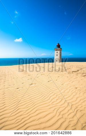 Abandoned Rubjerg Knude Lighthouse and sand dunes North Sea coast Denmark