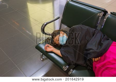 Young Asian woman feel tired because of flight delay