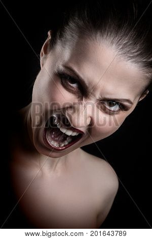angry nude girl screaming at camera on black background
