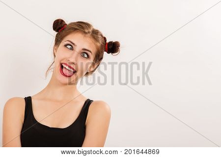 ridiculous fun girl grimaces on a white background with copy space