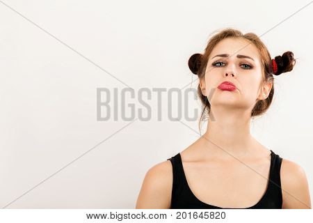 offended fun girl on white background with copy space