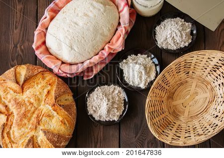 Homemade Dough, Sourdough In A Jar, Mix Of Flours, Bread And Basket For Proof And Spatula On A Woode