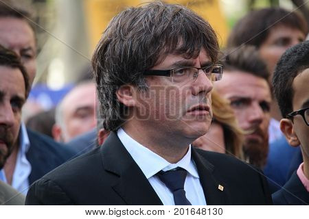 BARCELONA/SPAIN - 26 AUGUST 2017: Governor of Catalonia Carles Puigdemont  amongst the 500.000 people attending the massive protest again terrorism in Barcelona