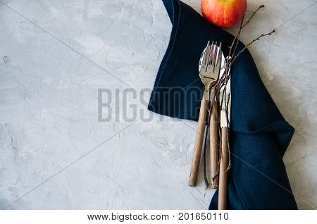White Plate, Red Apple And Brunches On A Wooden Background. Autumn, Thanksgiving, Halloween Concept.