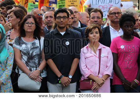 BARCELONA/SPAIN - 26 AUGUST 2017: Conservative politician Soraya Saenz de Santamaria (pink shrirt) participating in the protest againts terrorism after attack on Barcelona`s Rambla.