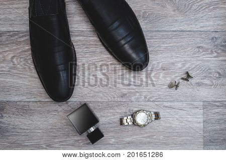 Businessman accessories. Man's style. Shoes wit perfume