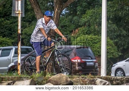 Kota Kinabalu,Sabah,Malaysia-Aug 8,,2017:Man enjoying cycling in pedestrian path & bicycle lane in Kota Kinabalu,Sabah.Malaysia is encouraging people to cycle for recreation & to commute to work.