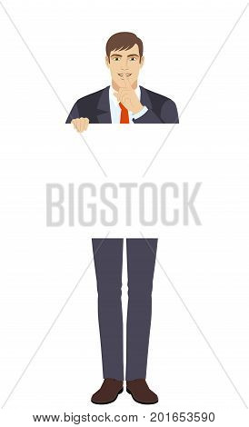 Businessman holding white blank poster and making hush sign. Full length portrait of businessman character in a flat style. Vector illustration.