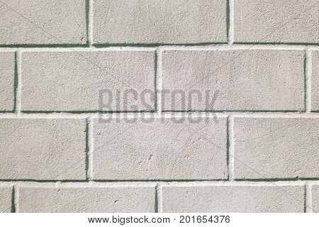 Old white painted brick wall close up background