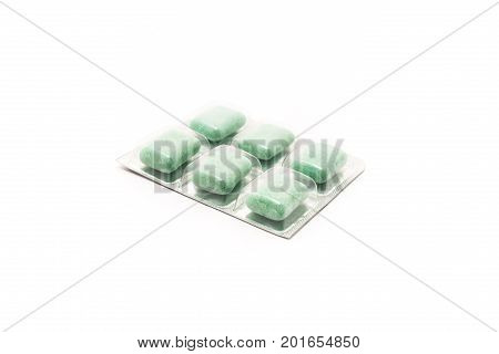 Chewing gum with a filling in a blister isolated on white background