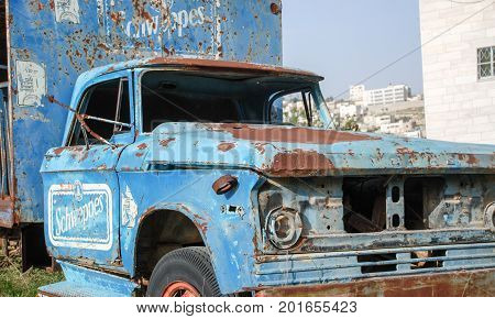 Abandoned Rusted Truck On Junkyard At Hebron