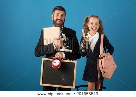 Father And Schoolgirl With Cheerful Faces On Blue Background