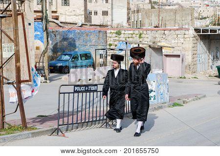 HEBRON ISRAEL - APRIL 12 2009: Undefined ultra orthodox jewish people walked on Hebron street