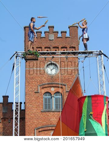 AALST, BELGIUM, AUGUST 27 2017: The juggling and acrobatic duo Circus unARTiq perform outside Aalst station, during the free open air festival Cirk. Cirk is a popular annual summer street festival.