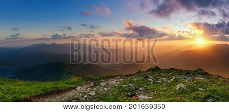 Amazing mountain landscape with colorful vivid sunset on the cloudy sky, natural outdoor travel background. Beauty world. Panoramic view.