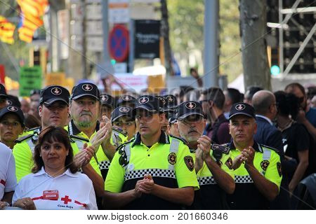 BARCELONA/SPAIN - 26 AUGUST 2017: Public service servants as firefighters, police, medical emergency services participating in the protest with over 500.000 participants against terrorism after attack on Barcelona`s Rambla.