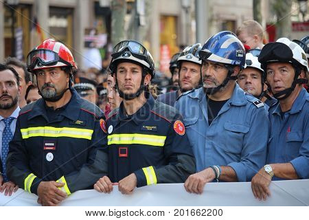 BARCELONA/SPAIN - 26 AUGUST 2017: Public service servants as firefighters, police, medical emergency services participating in the protest againts terrorism after attack on Barcelona`s Rambla, with over 500.000 participants