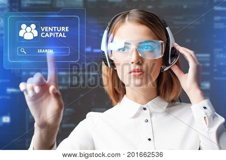 Young Businesswoman Working In Virtual Glasses, Select The Icon Venture Capital On The Virtual Displ