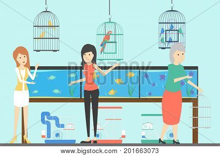 People at pet shop. Birds in cages, fish in aquariums and more.