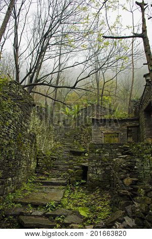 A stone old town in the foggy mountains