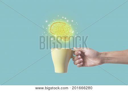 hand holding coffee cup with brain. concept for new ideas with innovation and creativity.