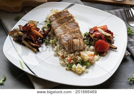 Pork medallions with grilled vegetables and vegetable couscous. Excellent food